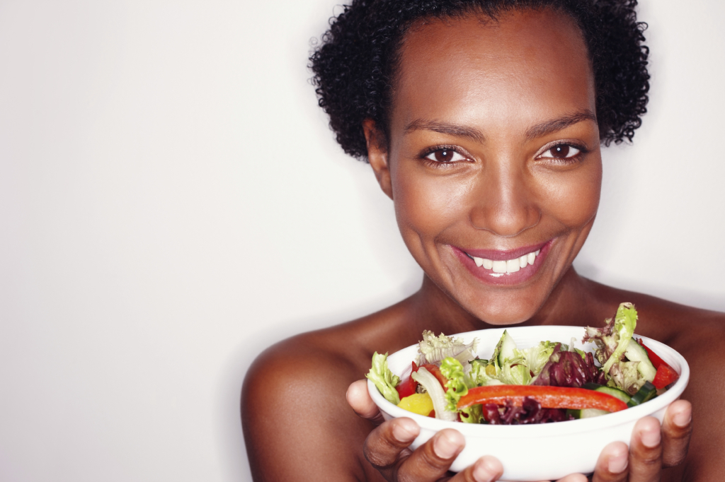 Closeup portrait of woman holding healthy salad